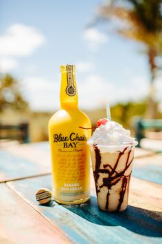 Add ingredients to a blender. Blend and pour into glass drizzled with chocolate. Garnish with whipped cream. Enjoy!