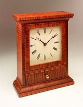 Clock made from curly maple and stained with an aniline dye.
