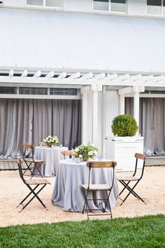 Wooden chairs and neutral linens let your venue shine.   - HarpersBAZAAR.com