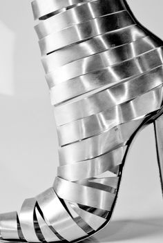 This is an unwearable shoe I made from strips of aluminium, with a steel sole cut using a water jet cutter.