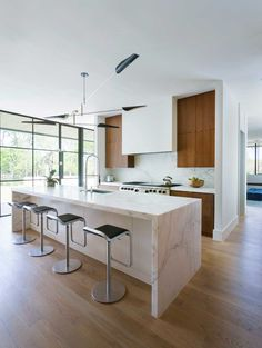 Courtyard House by Tim Cuppett Architects. Love this kitchen, especially the light fixture