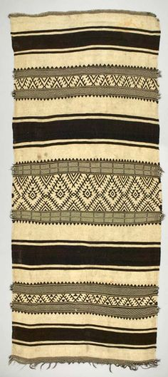 Africa | Rug ~ shadoui ~ from the Berber, Ait Ouaouzguite tribe from the High Atlas Mountain region in Morocco | ca. early to mid 20th century | Wool; weft-faced, weft twined, slit tapestry woven, fringed