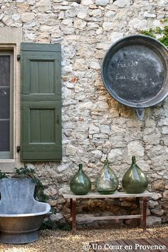 Love the green glass and hanging metal bucket
