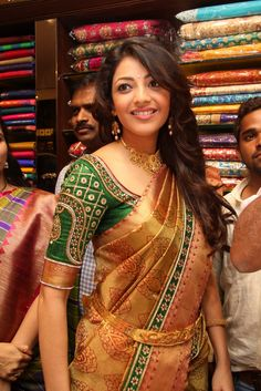 Kajal in gold Kanjeevaram saree and green golden threads work blouse.