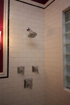 eclectic bathroom by Design Build 4U Chicago.  Like the subway tile & shower hardware.