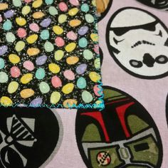 "Reinforced corner on one of the pockets. This is a,Star Wars Easter scrub, 50"" XL. Can make other size."