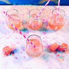 Ro-Slay Sprinkle Mimosa  - from Cosmopolitan.com - put sprinkles in ice cube tray, add rosé and freeze. Once frozen add the cubes to glass, top with champagne.