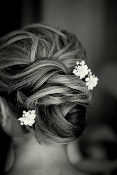 #Wedding #Hair. bun with flower.  Bun. Wedding hair with flowers flower accents hair accessories