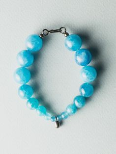 "Bracelet made from sky blue angelite gemstone with a hanging silver egg. It's part of ""Dans l'air"" collection. Blue Eggs, Bracelet Making, Air, The Dreamers, Turquoise Bracelet, Jewelry Design, Gemstones, Bracelets, Silver"