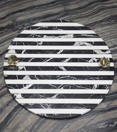 KELLY WEARSTLER   ACOLYTE ENTERTAINING PLATTER. Hand-carved marble platter with hand-picked pyrite cast in bronze
