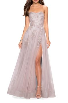 TYA2S La Femme Strapless Tulle Gown with Floral Appliques & High Skirt Slit Tulle Ball Gown, Tulle Prom Dress, Slit Dress, Strapless Dress Formal, Ball Gowns, Formal Gowns, Formal Dress, Bridesmaid Dress, High Skirts