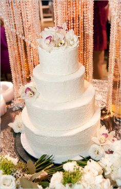 Sparkly white cake with an orchid topper!    Photo by Jason