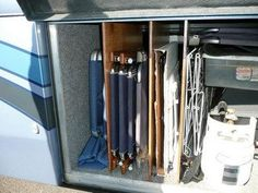 """RV Basement Storage Tip: Just cut and varnish 3/4"""" plywood pieces, then secure with L brackets at the top and bottom."""