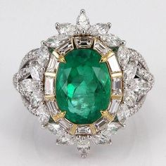 True green with a touch of sparkle. Emerald ring with diamonds