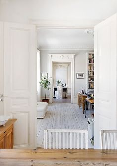 white wood floors & white interior design