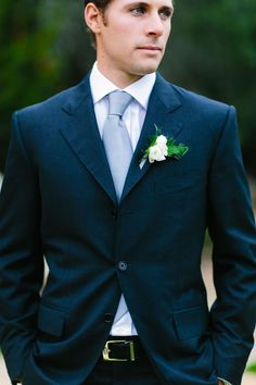 Groom: navy blue suit, rose and fern boutonniere | Rustic, Luxe, Romantic Texas Ranch Wedding at Camp Lucy | Al Gawlik Photography
