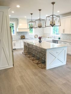 Modern Farmhouse Kitchen with X detail on island ends and side of fridge cabinet Kitchen with X detail on island ends and side of fridge cabinet #kitchen #Xislanddetail #xcabinet