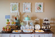 Peter Rabbit themed first birthday party! love the framed pics and the table