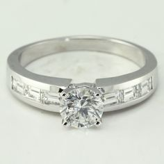 Round Diamond with Baguette Channel Set Diamond Engagement Ring