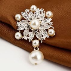 distintive & stylish BUYINHOUSE Silver Plated Flashing Rhinestones Crystals Pearls Flower Petals Leaves Brooches Pin Clips All-match Clothing Accessories Suitable for Any Occasions buyinhouse http://www.amazon.com/dp/B00LJOVMIU/ref=cm_sw_r_pi_dp_Txwaub18WX1ZM