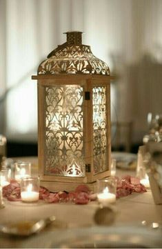 lanterns centerpieces DIY wedding planner with ideas and tips including DIY wedding decor and flowers. Everything a DIY bride needs to have a fabulous wedding on a budget! Lantern Centerpiece Wedding, Wedding Lanterns, Centerpiece Ideas, Non Floral Centerpieces, Centrepieces, Ramadan Decorations, Wedding Decorations, Table Decorations, Indian Wedding Centerpieces