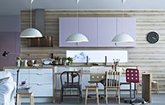 One of our favorite IKEA kitchens. Especially the wooden wall, purple cabinets and modern feel.