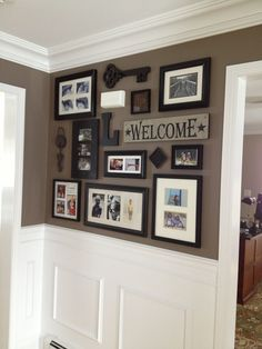 Picture collage for front entry and impressive wainscoting/crown moulding. Good paint scheme. #PhotoCollage
