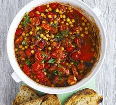 Chorizo & chickpea stew | BBC Good Food - so many variations of this scrumptious dish.  It works well with other pulses too, but chickpeas (garbanzo beans) add a lovely clean nutty taste that balances out the smokiness of the chorizo.  I know autumn is here when I start cooking this dish - it makes me think of frosty mornings, bonfires and cosy nights indoors!