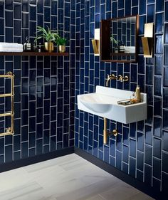 Deep Blue Metro or subway Tile - shiny and deep, dark and inky. Navy and brass combined is always a winning combination and this would make a spectacular bathroom update