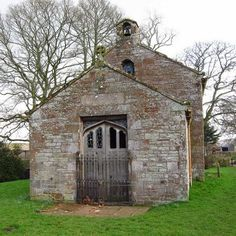 Abandoned Churches - A deserted rock church with the iron gates and the bell still in the tower