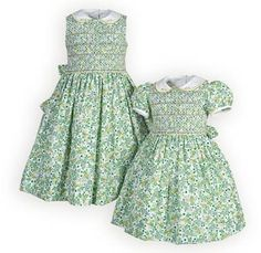 Modest girls garden dresses of bright green floral cotton brocade. Hand-smocked bodices with lovely lattice pattern and floral embroidery. White piqu