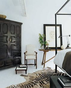 Darryl Carter - black / white bedroom love the rug and cabinet!