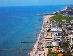 Jesolo Lido, I was there. Awesome beach and best shopping on the strip
