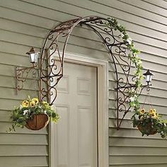 Over-the-Door Arch Trellis from Through the Country Door®. I love this minus the porch lights and the hanging baskets - i'd rather have grapevines or hops climbing this metal arch Outdoor Crafts, Outdoor Projects, Garden Projects, Outdoor Decor, Outdoor Ideas, Craft Projects, Dream Garden, Home And Garden, Garden Shop