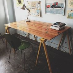 Excellent desk made with reclaimed wood from an old gym floor.