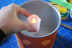 DIY Halloween luminaries from recycled baby formula cans - Merriment Design Diy Halloween Luminaries, Cute Halloween Decorations, Halloween Diy, Baby Formula Cans, Paper Lanterns, Glass Of Milk, Mason Jars, Recycling, Canning