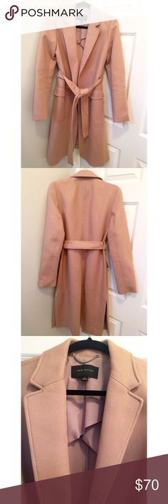 Ann Taylor blush colored coat with collar Ann Taylor blush colored coat. The color is so pretty and it's a great fit over a dress or outfit . Longer in length and has side slits at bottom . Ties at waist for a great fit. Pockets on front . Only worn once- needs a new home :) size small . Ann Taylor Jackets & Coats