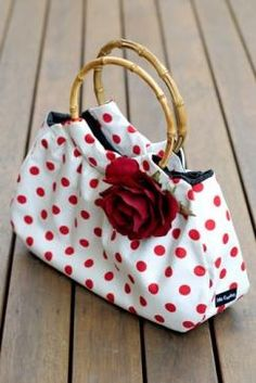 cute purse with polka dots and a single red rose