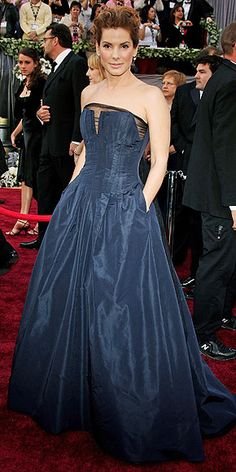 Sandra Bullock's Style Evolution | RED CARPET ANGEL   | She attended the 2006 Oscars with her Lake House co-star Keanu Reeves wearing a romantic strapless Angel Sanchez design and textured updo.