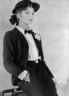 Model is wearing Chanel's navy-blue jersey suit which embodies her beloved androgynous look, from the 1954 Spring-Summer Collection, photo by Henry Clarke.