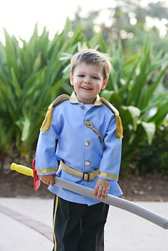 Adorable Prince Charming ring bearer at a Disney's Fairy Tale Wedding