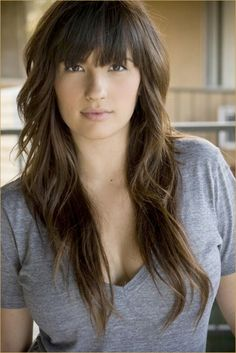 Can I just have her hair.. well minus the bangs and brown :) Length and curls are perfect though!