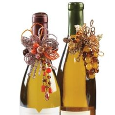 HAVE to figure out how to make these!!!!  Crystal and White Wine Bottle Jewelry -- www.grandinroad.com  $15 ea.