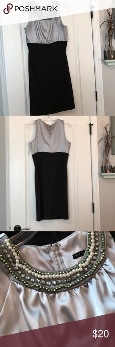 Silver and black cocktail dress Size 6 cocktail dress. Very comfortable. Form fitting at the bottom Dresses