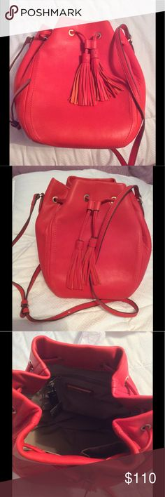 J Crew Bucket Bag 24 HOUR SALE J Crew Tassel Tie Bucket Bag is NEW with tags. Smooth leather in warm flame. Bag is in brand new condition. Measurements 11 3/4 high, 8 1/4 wide, 6 diameter. 22 handle drop. J. Crew Bags Crossbody Bags