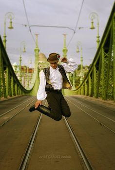 Hungarian man dancing on the Liberty Bridge, Budapest, Hungary Folk Costume, Costumes, Hungarian Dance, Liberty Bridge, Folk Clothing, Heart Of Europe, Folk Dance, Folk Fashion, Budapest Hungary