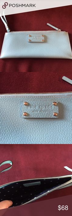 "Kate Spade Leather Wristlet Kate Spade leather wristlet in light blue (similar to the current Cy-Blue color). Measures about 4"" x 9"" and zips closed. Has black and white polka dot interior. Like new condition with one tiny mark on back - see pic (you can barely see it, but I wanted to point it out). I believe this is the Chrissy Berkshire Pouch (but there are no tags). kate spade Bags Clutches & Wristlets"