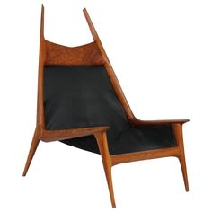 Studio craft lounge by Bay Area woodsmith Miles Karpilow, impressive scale and form, created out of an richly hued walnut with leather upholstery.
