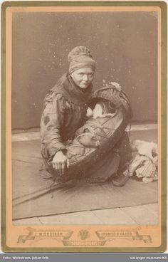 Portrait of a Sami woman breastfeeding