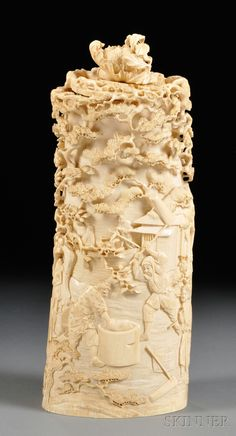 Large Ivory Carving, Japan, 19th century, cylindrical, depicting a scene from village life with blossoming flower branches at the top, includes a cover with a peony finial, signed under lid, ht. 12 3/8 in.